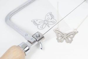 saw pierced butterfly pendant